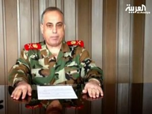 Abulaziz al-Shalal, commander of Syria's military police, has defected from President Bashar al-Assad's government and reportedly fled to Turkey