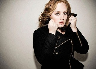 Adele has been named Billboard's top artist of 2012, while her hit record 21 was named top album of the year in the music magazine's annual review
