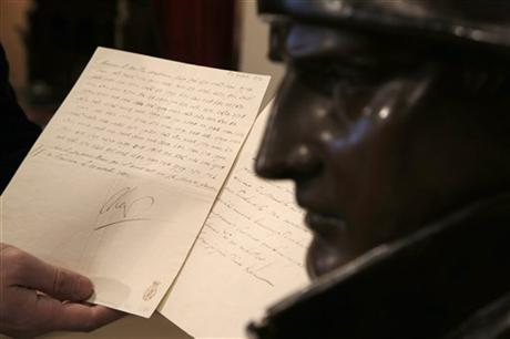 An 1812 letter written by Napoleon Bonaparte in which he vows to blow up the Kremlin has been sold at a Paris auction for 150,000 euros