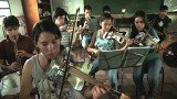 An orchestra of young musicians from a Paraguayan slum has been touring South America, using instruments constructed entirely from recycled materials