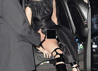 Anne Hathaway has been caught going commando in embarrassing pictures taken at the premiere of her new film, Les Miserables