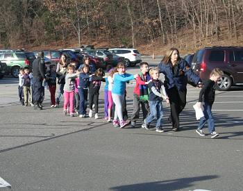 At least 18 children are among the dead at Sandy Hook Elementary School in Newtown
