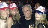 DSK was caught on camera brazenly posing with the attractive young women during a night out with pals in Paris