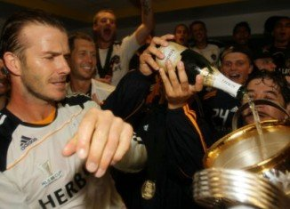 David Beckham crowned five and a half years at LA Galaxy by retaining the MLS Cup with a 3-1 win over Houston Dynamo in his final game