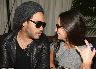Demi Moore was seen exhibiting some very bizarre behavior at a Chanel party with Lenny Kravitz on Wednesday night