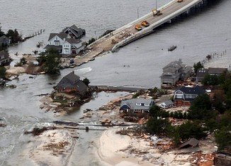 Ed Wright's house was surrounded on all sides by water after Superstorm Sandy breached the protective sand dunes in his community