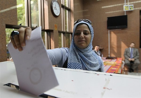 Egyptians have begun voting on a new constitution endorsed by the Islamist president Mohamed Morsi, which has divided the country and sparked deadly unrest