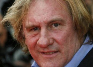 Gerard Depardieu announces he is handing back his French passport after Prime Minister Jean-Marc Ayrault criticized him for moving to Belgium to avoid taxes
