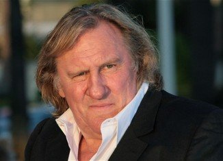 Gerard Depardieu was spotted stocking up on his favorite cheese before flying to Italy, sparking rumors that he has finally left France for good