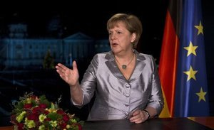 German Chancellor Angela Merkel has warned that her country's economic climate in 2013 will be even more difficult photo
