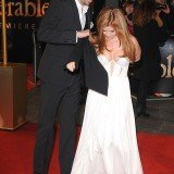 Isla Fisher stole the show from her husband Sacha Baron Cohen in daring plunging white gown at the London premiere of Les Misérables