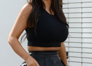Kim Kardashian was seen spilling over the top of her peplum skirt