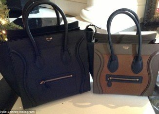 Kylie Jenner continued to flaunt her privileged lifestyle by posting Instagram snaps of the two expensive-looking Céline luggage-mini purses she received under the Kardashian Christmas tree