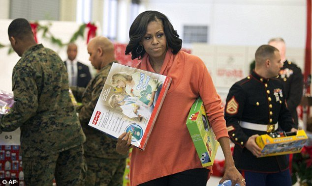 Michelle Obama delivered about 900 gifts to the Marine Corps' Toys for Tots campaign but perhaps lost in the seriousness of her mission, forgot to wear her smile