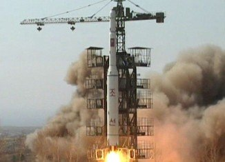 North Korea has announced an apparently successful launch of a long-range rocket defying international warnings