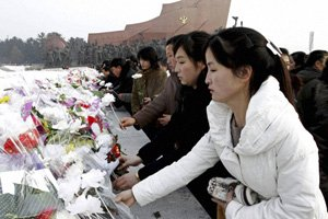 North Korea marks one year since the death of Kim Jong-il in a huge ceremony, days after the country's successful rocket launch