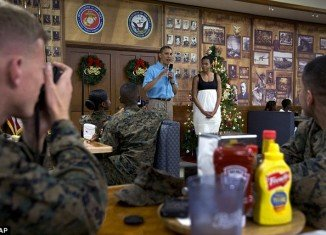President Barack Obama and First Lady Michelle Obama wished the troops a merry Christmas with a visit to a Marine base in Hawaii on Tuesday