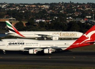 Qantas Airways has been given initial approval from Australia's competition authority for its proposed alliance with Dubai-based Emirates