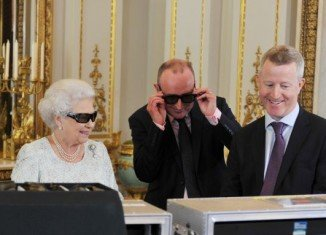 Queen Elizabeth II wore dark glasses with a glittering Swarovski Q on each side while she was watching a preview of her Christmas message