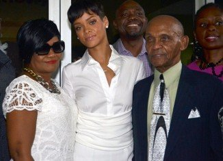 Rihanna was accompanied by grandmother Dolly's husband, Lionel, and her mother, Monica Fenty as she has donated $1.75 million to a Barbados cancer hospital