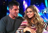 Simon Cowell has confirmed he is dating TV presenter and model Carmen Electra