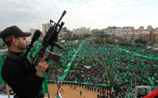 Tens of thousands of people have gathered to attend a rally in the Gaza Strip to mark the 25th anniversary of the Palestinian Islamist group Hamas