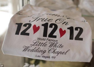 Thousands of brides hoping to add some auspicious significance to their walk down the aisle tie the knot on December 12th 2012, the last triple-digit date for one hundred years
