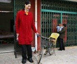 Yao Defen, the world's tallest woman, who measured a gigantic 7ft 8in, passed away last month aged just 40