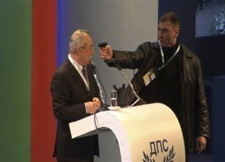 A man put a gun to the head of Ahmed Dogan, the leader of Bulgaria's ethnic Turkish party, during a televised conference in Sofia