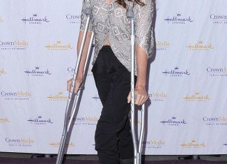 Andie MacDowell on crutches at the Hallmark Channel TCA Winter Press Gala in San Marino, California