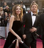 Angelina Jolie and Brad Pitt are rumored to have married in a Christmas Day ceremony in the Caribbean