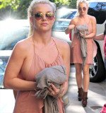 Britney Spears came pretty close to losing part of her dress on her way to lunch on Saturday afternoon