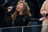 Conflicting reports have emerged over whether Beyonce sang live the National Anthem