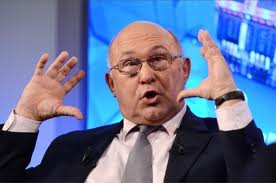 French Employment Minister Michel Sapin made it clear that his governments tax and spend policies are just not working and admitted that France is bankrupt photo