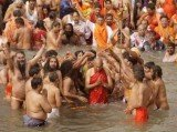 Hundreds of thousands of people have been bathing at the confluence of the Ganges and Yamuna rivers at Allahabad in India, on the opening day of the 2013 Kumbh Mela festival