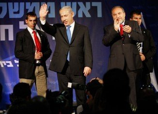Israeli PM Benjamin Netanyahu has pledged to form as broad a government as possible after his alliance won a narrow election victory