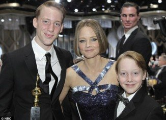 Jodie Foster plans to tell her beloved sons who their father is when they turn 21, the mother of the star's best friend claimed today