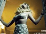 Kate Upton has posed for V magazine in a series of poses that evoke the seedy spirit of the early '60s