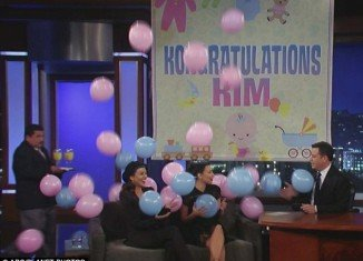 "Kim Kardashian got a surprise baby shower and book of names that start with ""K"" when she made an appearance with sister Kourtney on Jimmy Kimmel Live on Tuesday"