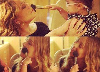 Mariah Carey uploaded an adorable set of photos of her 20-month-old daughter Monroe applying powder to her famous mother's face