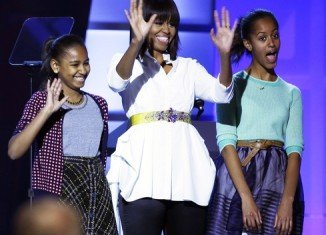 Michelle Obama paraded her new haircut as she took the stage with her daughters at Kids' Inaugural Concert