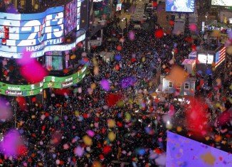 Revelers in Times Square welcomed in 2013 with a spectacular display of fireworks and confetti as they watched the famous Waterford crystal ball make its annual descent to mark the New Year