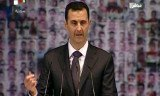 Syria's President Bashar al-Assad has delivered a rare TV address, denouncing his opponents as enemies of God and puppets of the West