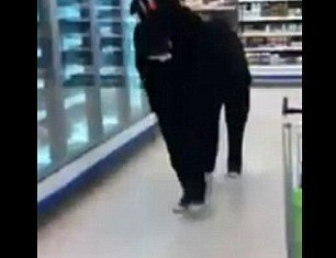 Two pranksters dressed up as a pantomime horse were thrown out of a UK Tesco supermarket after trotting around the frozen beef burger aisle