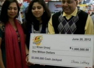 Urooj Khan pictured with wife Shabana Ansari, daughter Jasmeen and his $1 million winnings shortly before his death from cyanide poisoning