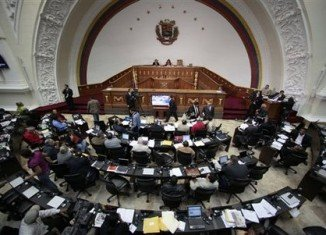 Venezuelan National Assembly is due to begin its new session as the ill-health of President Hugo Chavez casts doubt over his inauguration on January 10