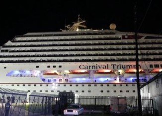All 3,200 passengers have now disembarked from crippled Carnival Triumph cruise ship that reached the US coast four days after an engine fire knocked out power