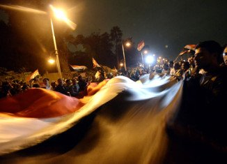 Anti-Mohamed Morsi protesters have clashed with police outside the presidential palace in Cairo, after a week of violence in which more than 60 people were killed