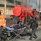 At least 30 people have been killed after gunmen and a suicide bomber attacked a police headquarters in the northern Iraqi city of Kirkuk
