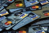 Eighteen people have been charged with stealing at least $200 million in a credit card fraud ring, possibly one of the largest in US history
